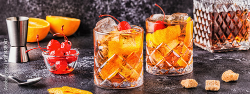 Fototapeta Old fashioned cocktail with cherries and orange twist. obraz