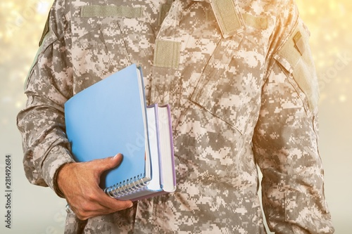 Fotografija National military force man with notebooks isolated on background