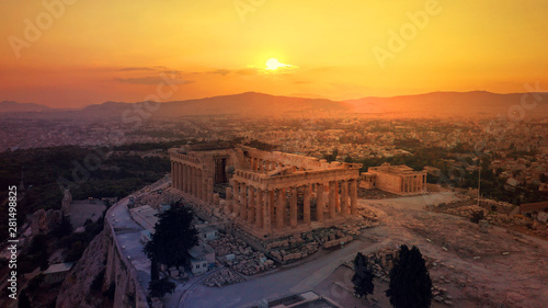 Aerial drone photo of iconic Acropolis hill and the unique masterpiece of Ancient world the Parthenon at sunset with beautiful golden colours, Athens historic centre, Attica, Greece