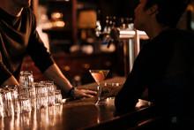 Friends Having Drink In Bar