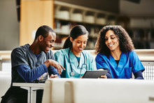 Group Of Nurses Using Digital ...