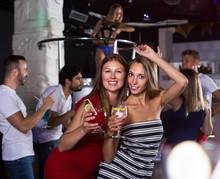 Women Friends With Cocktail Dancin