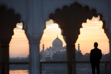 Rear View Of Man Looking At Taj Mahal Palace During Sunset