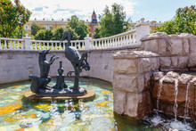 Figures Of Fairytale Characters In Fountains On Manezhnaya Square In Moscow At Sunny Summer Morning