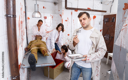 Focused guy in escape room with traces of blood Tablou Canvas