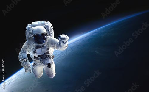 Fotomural Astronaut in the outer space over the planet Earth