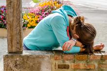 Young Woman Lying Like Crying ...