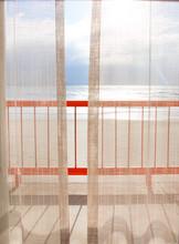 View Of Beach Seen Through Gauze Curtain