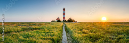 Spoed Fotobehang Landschap Panorama of the Westerheversand Lighthouse at Westerhever in Nordfriesland in the German state of Schleswig-Holstein