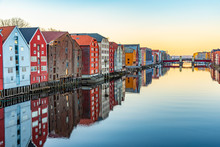 Sunset View Of Colorful Timber Houses Surrounding River Nidelva In The Brygge District Of Trondheim, Norway