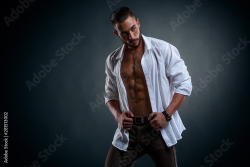 Fototapety, obrazy: Handsome Male Model Wearing Unbuttoned White Shirt Exposing His Muscular Torso