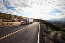 Commercial Truck Driving On Road