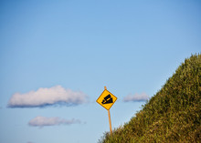 Steep Grade Caution Sign On Hill
