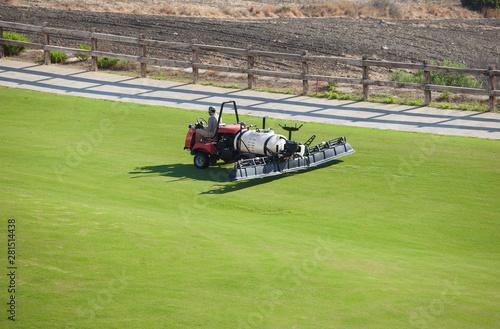 Sprayer machine performing maintenance at golf course. Shelf propelled vehicle - 281514438