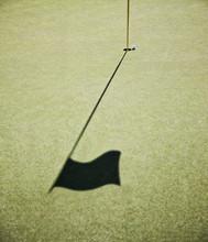 Shadow Of Golf Flag On Golf Course