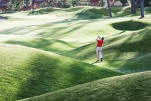 Rear View Of Golfer Playing Golf On Golf Course