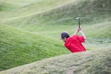 Senior Golfer Playing Golf On Golf Course