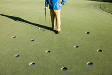 Low Section Of Golfer Standing On Golf Course