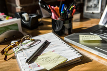 Close Up Of Office Supplies On Desk