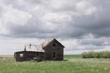 Abandoned Farmhouse On Prairie