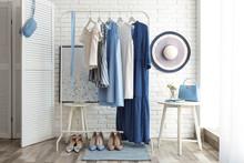 Wardrobe Rack With Women's Clo...