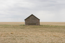 View Of Old Barn In Fallow Field