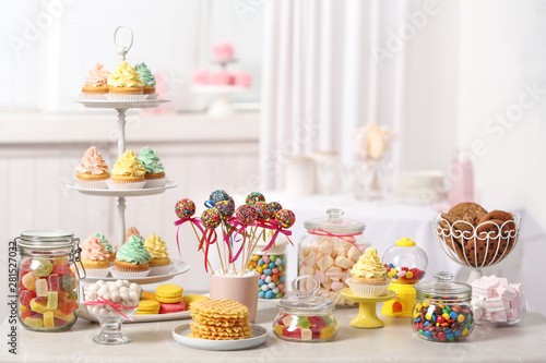 Fotografie, Obraz  Candy bar with different sweets on white table against blurred background