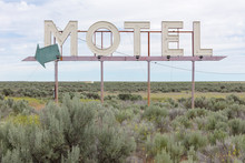 View Of Motel Sign In Field Of Sage Bush