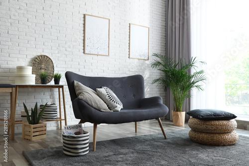 Fototapeta Stylish living room with modern furniture and stylish decor. Idea for interior design obraz