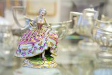 Color Vintage Porcelain Doll In Blurry Background