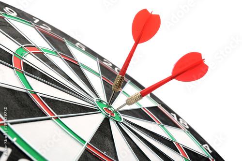 Fotografía  Dart board with color arrows hitting target, closeup