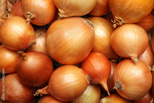 Fresh whole onions as background, top view Wallpaper Mural