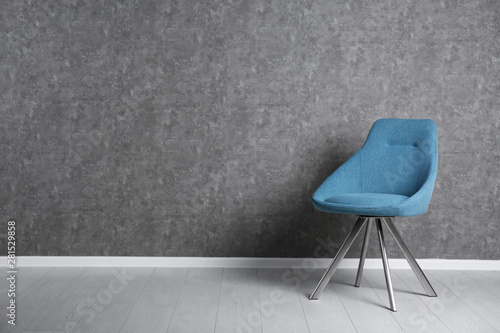 Fotografia, Obraz  Blue modern chair for interior design on wooden floor at gray wall