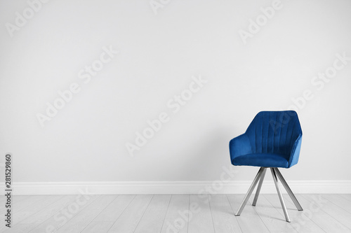 fototapeta na lodówkę Blue modern chair for interior design on wooden floor at white wall