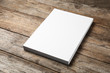 canvas print picture Stack of blank paper sheets for brochure on wooden background. Mock up