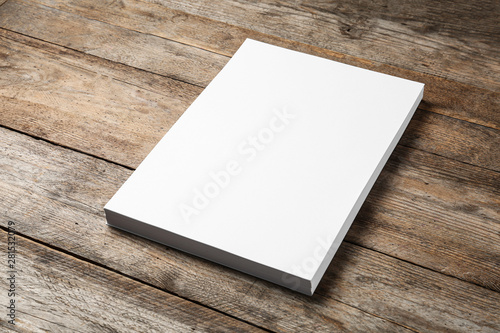 Valokuva  Stack of blank paper sheets for brochure on wooden background