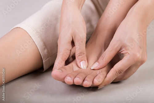 Cuadros en Lienzo  Healthcare and medical concept. Woman massaging her painful foot.