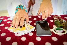 Fortune Teller Reading Fortune Lines On Screen Smartphone Modern Horoscopes Online Fortune Telling Application Palmistry Psychic Readings And Clairvoyance Hands With Tarot Cards Divination