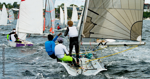 Photo Children Sailing small boats and dinghies on salt water.
