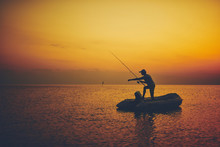 Silhouette Of A Fisherman Fish...