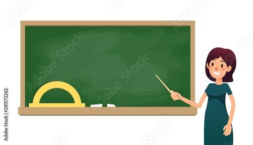Foto School teacher in classroom near blackboard