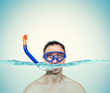 Happy Funny Man In A Swimming Mask With Snorkel Is In The Water. Sea Holiday Concept.