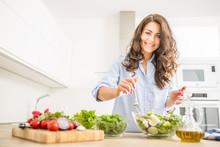 Young Woman Preparing Vegetabl...