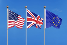 Three Colored Silky Flags In The Wind: USA (United States Of America), EU (European Union) And United Kingdom. 3D Illustration.