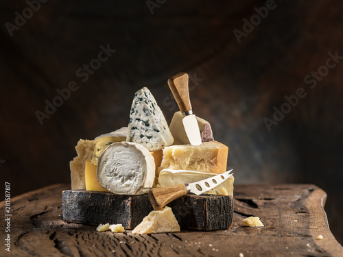 Fotobehang Schapen Assortment of different cheese types on wooden background. Cheese background.