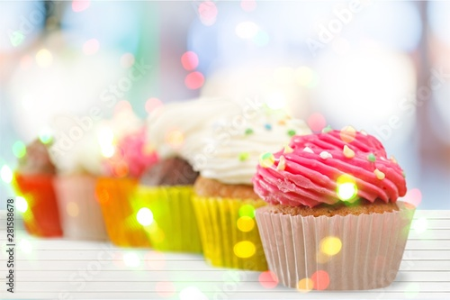 Photo  Tasty Colorful cupcakes on background