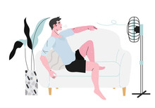 A Sweaty Man Sitting On A Sofa In Front Of A Fan During Hot Summer Days And Suffering From Terrible Heat.