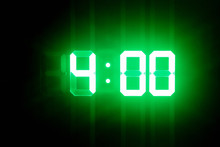 Green Glowing Digital Clocks I...
