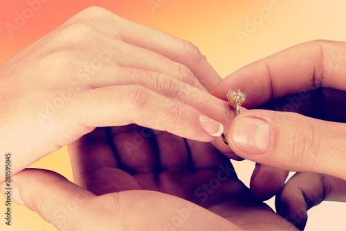 Photo sur Toile Nature Close up Groom Putting the Wedding Ring on bride