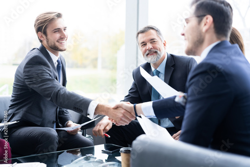 Business people shaking hands, finishing up a meeting Wallpaper Mural